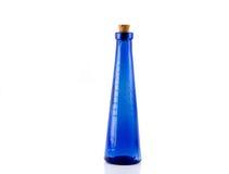 Blauwe fles met cork royalty-vrije stock afbeelding