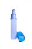 Blauwe fles met een automaat Stock Fotografie