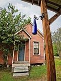 Blauwe Fles met Oud Huis op Achtergrond Stock Foto