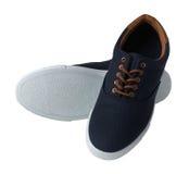 Blauwe geïsoleerde tennisschoenen Stock Afbeeldingen