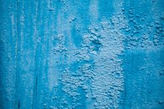 Blauwe gebarsten verf en houten, abstracte achtergrond royalty-vrije stock foto