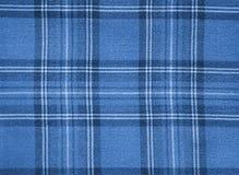 Blauwe gecontroleerde stof Stock Foto's