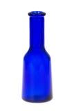 Blauwe gekleurde die geneeskundefles, op wit wordt geïsoleerd Stock Foto