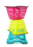 Blauwe, gele en roze plastic het winkelen mand. Royalty-vrije Stock Afbeeldingen