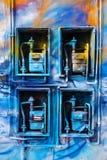 Blauwe geschilderde Gasmeters Stock Fotografie