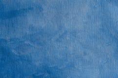 Blauwe geschilderde textuur als achtergrond met parelachtige flikkering royalty-vrije stock foto's