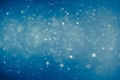 Blauwe glanzende bokehachtergrond stock foto's