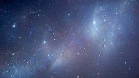 Blauwe gloeiende nevel, sterren en melkwegen op starfield Royalty-vrije Stock Afbeeldingen