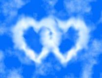Blauwe hemel en hart-vormige wolken Royalty-vrije Stock Foto