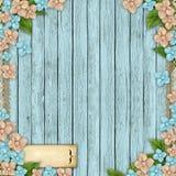 Blauwe houten achtergrond met bloemen Stock Foto