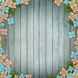 Blauwe houten achtergrond met bloemengrens Stock Afbeeldingen