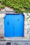 blauwe houten deur Stock Afbeeldingen