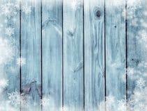Blauwe houten textuur Geheimzinnige Kerstnacht De winter De donkerblauwe achtergrond van Kerstmis Sneeuw en sneeuwvlokken Stock Foto