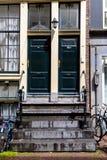 Blauwe huisdeur Stock Foto