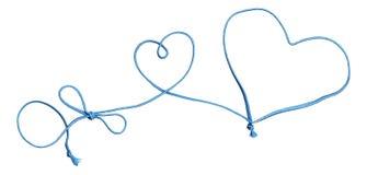 Blauwe kabelwerveling met hart en boog Stock Foto