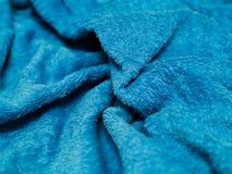 Blauwe katoenen stof met rimpels Stock Foto's