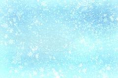 Blauwe Kerstmis achtergrondsneeuwtextuur, abstractie, sneeuwvlokken stock foto