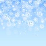 Blauwe Kerstmisachtergrond met sneeuwvlokkenvector Stock Afbeeldingen