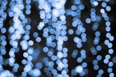 Blauwe lichte bokehachtergrond Stock Foto