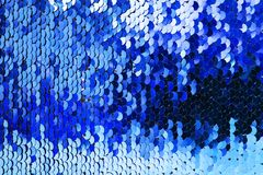Blauwe lovertjesachtergrond royalty-vrije stock afbeelding