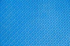 Blauwe mattextuur op achtergrond Stock Afbeeldingen