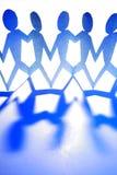 Blauwe mensencijfers aangaande wit Royalty-vrije Stock Foto