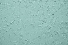 Blauwe muur met in reliëf gemaakte gipspleister Stock Foto