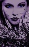 Blauwe ogen van een geheimzinnige vrouw royalty-vrije stock foto