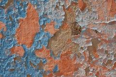 Blauwe, oranje schilverf op de muur Royalty-vrije Stock Foto's