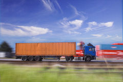Blauwe oranje vrachtwagen Stock Foto's