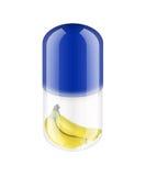 Blauwe pil met banaan Stock Afbeeldingen