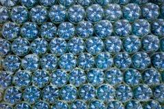 Blauwe plastic flessen Stock Afbeelding
