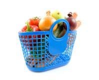 Blauwe plastic het winkelen zak met kruidenierswinkel Royalty-vrije Stock Foto's