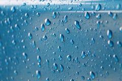 Blauwe regendruppels Stock Afbeeldingen
