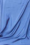 Blauwe satijnachtergrond Royalty-vrije Stock Afbeeldingen