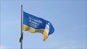 Blauwe schone het strandtoekenning 2109 van de vlagkust van de de kustvakantie van Kent van het het watermilieu de kuststranden stock video
