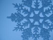 Blauwe sneeuwvlokachtergrond stock afbeelding