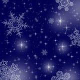 Blauwe sterachtergrond met sneeuwvlokken Royalty-vrije Stock Afbeeldingen