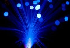 Blauwe stralenexplosie stock foto