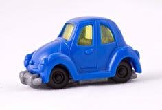 Blauwe stuk speelgoed auto Stock Foto's