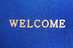 Blauwe tapijt welkome mat. Stock Afbeeldingen