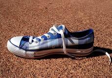 Blauwe tennisschoen Royalty-vrije Stock Foto's