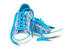 Blauwe tennisschoenen Royalty-vrije Stock Afbeeldingen