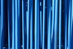 Blauwe tubulaire metaalachtergrond Industrieel abstract materiaal Royalty-vrije Stock Foto's