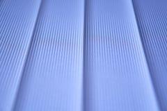 Blauwe verticale zonneblinden Stock Foto's