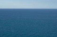 Blauwe Water en Hemel Stock Foto's