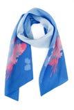 Blauwe zijdesjaal met kleuren op een witte achtergrond stock foto