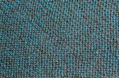 Blauwe zwarte draden in stof stock foto