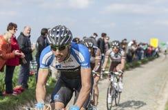 Blaz Jarc- Paris Roubaix 2014. Carrefour de l'Arbre,France-April 13,2014:The Slovenian cyclist Blaz Jarc from NetApp-Endura Team riding on the famous cobblestone Royalty Free Stock Photo