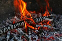 Blaze of bonfire wood fire flame spires in fireplace Stock Images